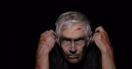 zalim : Old executioner Halloween man portrait. Elderly man with dripping blood on his face. Executioner, headman makeup. Fashion art design. Attractive model in Halloween costume. Black background