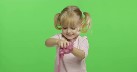 goop : Child having fun making ping slime. Kid playing with hand made toy slime. Funny kid girl. Relax and Satisfaction. Oddly satisfying pink slime for pure fun and stress relief. Green screen. Chroma Key