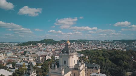 liturgia : Aerial view of St. Jura (St. Georges) Cathedral church against cloudscape in old town Lviv, Ukraine. Flying by drone over Greek Catholic Cathedral of city. Main shrine of the Ukrainian Greek Catholic