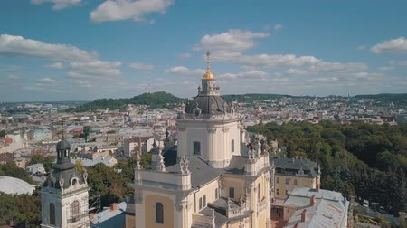 liturgy : Aerial view of St. Jura (St. Georges) Cathedral church against cloudscape in old town Lviv, Ukraine. Flying by drone over Greek Catholic Cathedral of city. Main shrine of the Ukrainian Greek Catholic