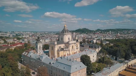 gods : Aerial view of St. Jura (St. Georges) Cathedral church against cloudscape in old town Lviv, Ukraine. Flying by drone over Greek Catholic Cathedral of city. Main shrine of the Ukrainian Greek Catholic
