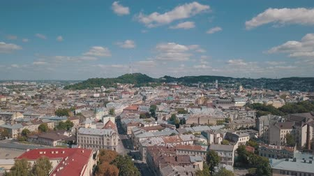 guildhall : Aerial roofs and streets Old City Lviv, Ukraine. Central part of old european city in day time. Panorama of the ancient town. City Council, Town Hall, Ratush. Drone shot