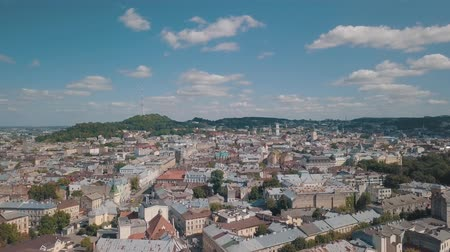 dominican : Aerial roofs and streets Old City Lviv, Ukraine. Central part of old european city in day time. Panorama of the ancient town. City Council, Town Hall, Ratush. Drone shot