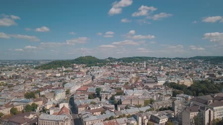 lviv : Aerial roofs and streets Old City Lviv, Ukraine. Central part of old european city in day time. Panorama of the ancient town. City Council, Town Hall, Ratush. Drone shot
