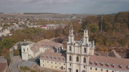 Западная Европа : Monastery located in the city Buchach (Ternopil region, Ukraine). Aerial view of catholic cathedral monastery in autumn