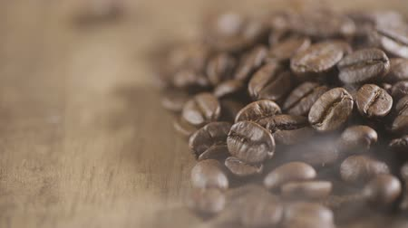 saborear : Fried coffee beans, delicious aroma, covered with smoke, roasted grain cafe flavor taste hot fresh smell morning.