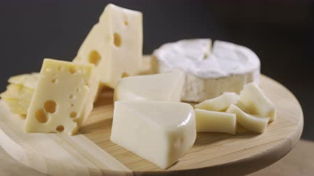 wooden type : Pieces of different cheeses on plate
