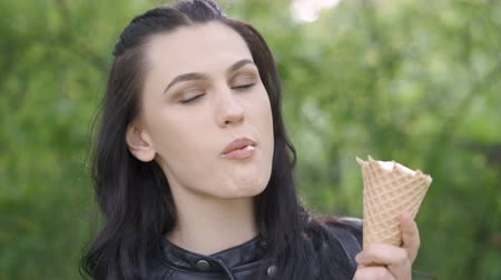 waffles : Beautiful woman eating ice cream in the park, close up. Stock Footage