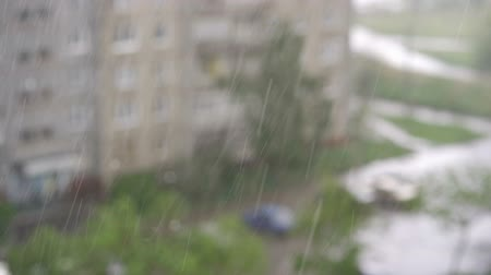 squirting : Slow motion closeup of heavy rain falling down in the street Stock Footage