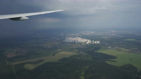 légtér : View of green landscape from airplane flight, clouds formations of rainy fall land Stock mozgókép