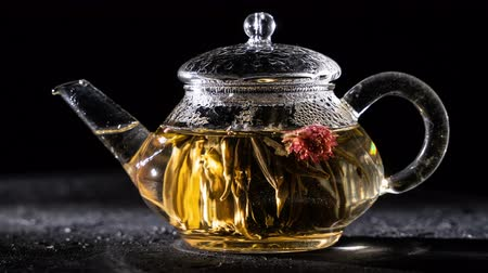 brew tea : Florescence of green Blooming Tea. Stock Footage