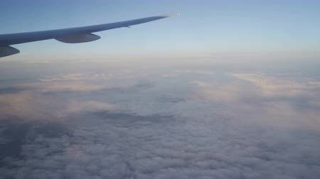 irreal : Clouds, sun, sky as seen through window of an aircraft Stock Footage
