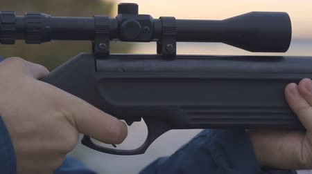homicide : stock footage hunter with rifle with telescopic sight