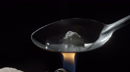 methamphetamine : Mans hand sets fire the lighter over spoon of boiling drug, diluted heroin. Social degradation, self-destruction of narcomaniac junkie. Stock Footage