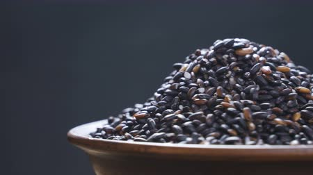 basmati : Black rice rotates. Close-up
