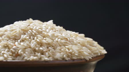 home grown : rotating close up of a pile of raw rice