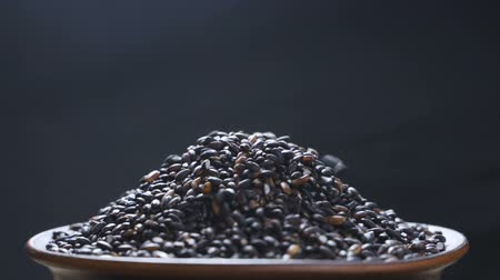 basmati : The grains of black rice falling. Background with selected rice rotates