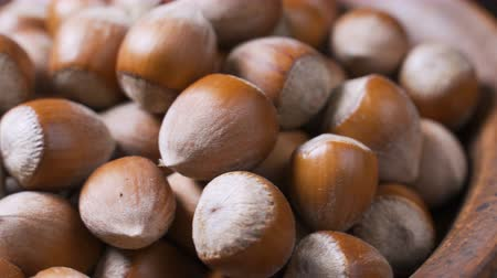 dilis : A pile of shelled hazelnuts rotating smoothly and slowly. Macro shot
