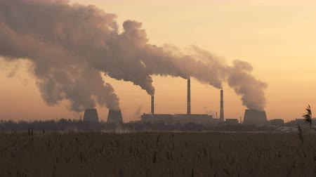 Chimneys of Power Plant at Sunset. Air Pollution Concept. Stock Footage