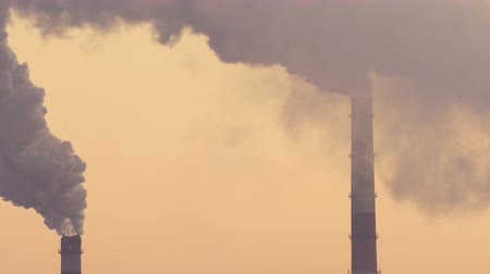 air pump : Chimneys of Power Plant at Sunset. Air Pollution Concept. Stock Footage