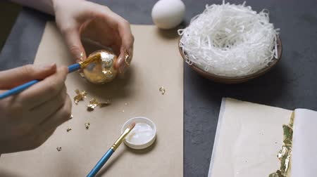 oval : A decorated chicken egg with a gold foil.