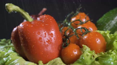 stopmotion : Top shot of fresh vegetables and fruits appearing on grey kitchen countertop.