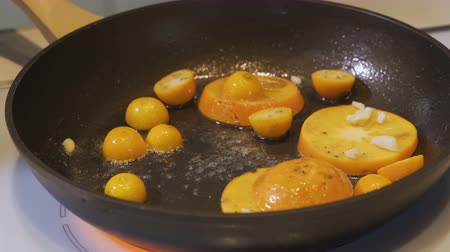 american cuisine : Fruits frying with caramel in frying pan, close-up in slow motion Stock Footage