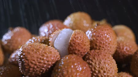 lychees : 4k Close up ,dolly shot of red exotic Chinese lychee fruits