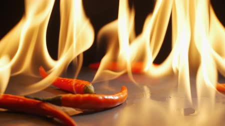chilli sauce : red peppers fall into the fire.