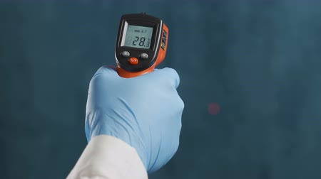 infra : infrared laser thermometer in hand Stock Footage