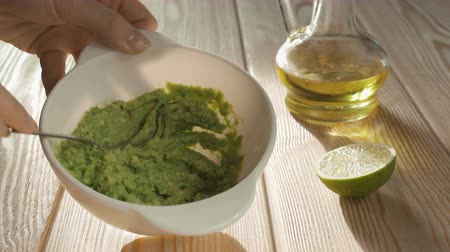dips : Making guacamole with a fork, avocado recipe, cooking guacamole Stock Footage