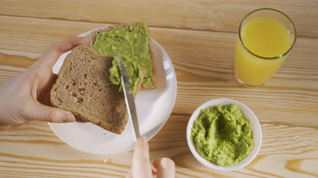 Top View Of Healthy Breakfast With Avocado Toast And Orange juice. Closeup.