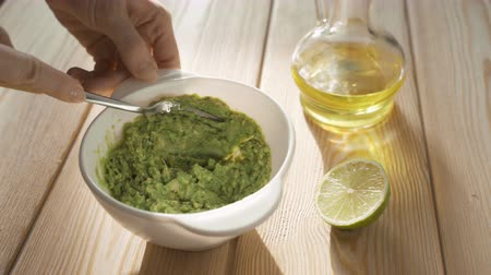 villa : Making guacamole with a fork, avocado recipe, cooking guacamole Stock mozgókép