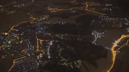 A view of the night city from the airplane window. Moscow. Wideo