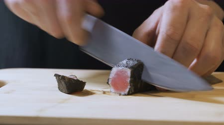 Chef cutting tuna. Sliced red fish