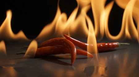Peppers and flames in super slow motion