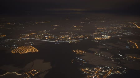Aerial view from airplane window over Los Angeles City Lights on approach to landing at airport Stock Footage