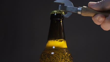 Opening cold bottle of beer with steam and spray Stock Footage