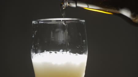 Pouring Cold Beer into a glass with water drops. Craft Beer close up. Wideo