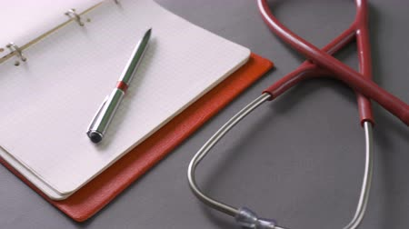 Healthcare and medical concept: M Stethoscope on prescription clipboard on workplace in hospital,
