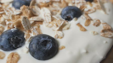 yoghurt : Composition of a typical genuine breakfast made with yogurt, blueberries, muesli.