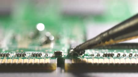 Close-up shot of electronics repair. Wideo