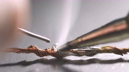 Stranded copper wires soldering with electrical solder using hand soldering iron tool.