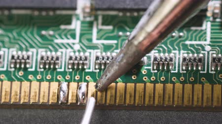 Close-up shot of electronics repair. Electronics repair soldering microchips