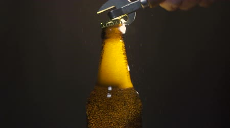 pat : Opening of beer cap with the gas output Stock Footage