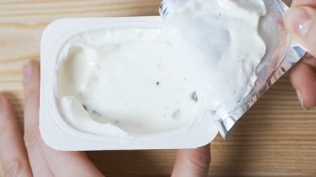 macrobiotic : Opening a jar of yogurt