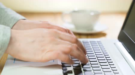 книжный магазин : Female hands typing on laptop, drinking coffee. Keyboard typing hands.