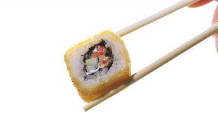 икра : Sushi with chopsticks isolated on a white background