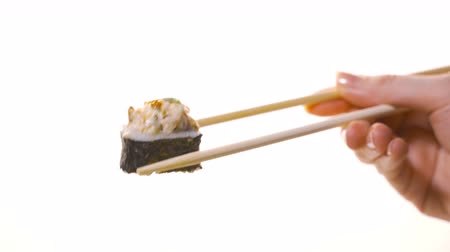 california rolls : Sushi with chopsticks isolated on a white background