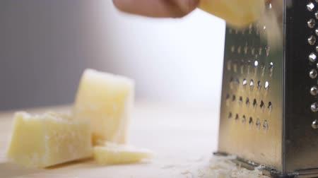 aprított : Cheese grater full closeup with cheddar cheese Stock mozgókép